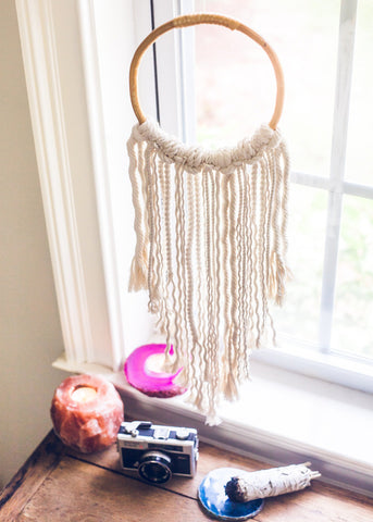 Rattan hoop with rope fringe hanging in window by SoulMakes