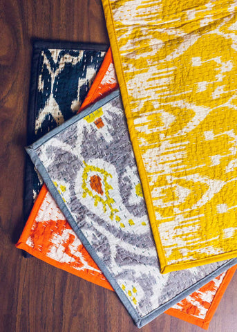 Yellow, orange, and black Ikat kantha placemats by SoulMakes
