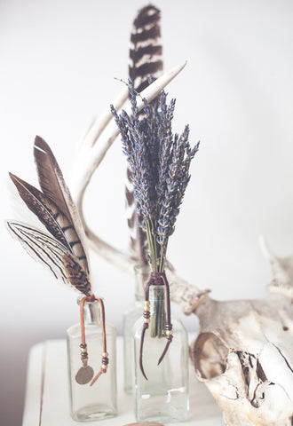 Bouquet of dried lavender stems in glass bottles by SoulMakes