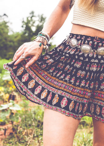 Bohemian girl in patterned skirt wearing bracelets and rings by SoulMakes