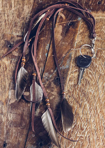 Extra long leather fringe and feather festival keychain by SoulMakes
