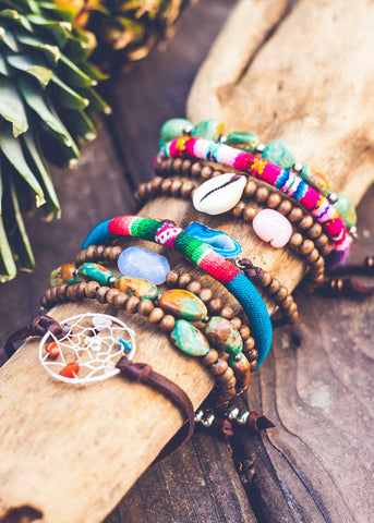 Stack of unique and colorful bohemian bracelets by SoulMakes