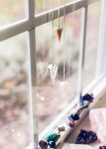 Faceted crystal pendulum ornaments hanging in window by SoulMakes