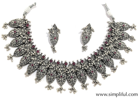 Oxidized ruby stone embedded silver ghungru hanging choker necklace and earring set - Simpliful