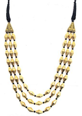 Celebrity style triple stranded gold dholki bead necklace on black dori thread cord - Simpliful