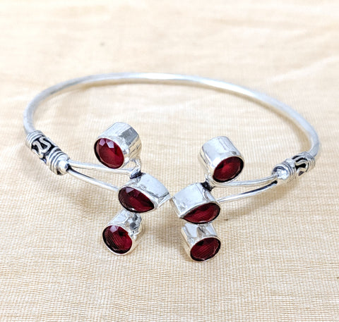 Bright silver finish adjustable bangle bracelet with color stone