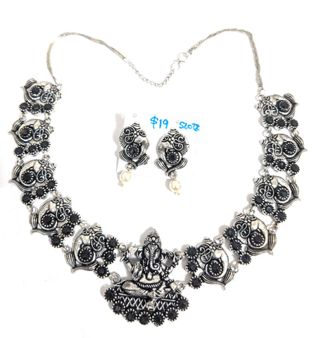 Lord Ganesha Oxidized silver choker with polki stone embedded Necklace and stud earring set