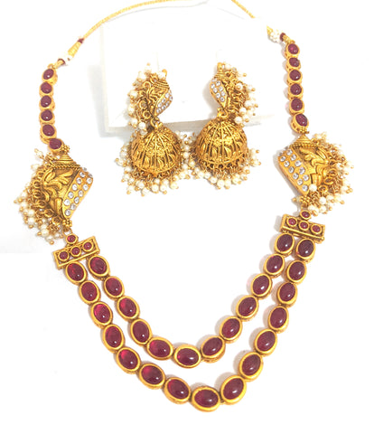 Traditional matte gold finish oval kemp stone side shell with pearl cluster dual stranded Necklace and jhumka earring set