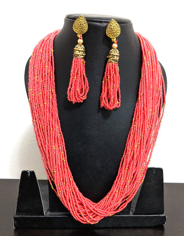 Bold statement seed bead multi stranded chain necklace with tassel style earring set