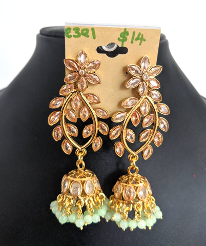 Antique gold polished shiny honey yellow stone pasted leaf design jhumka earrings