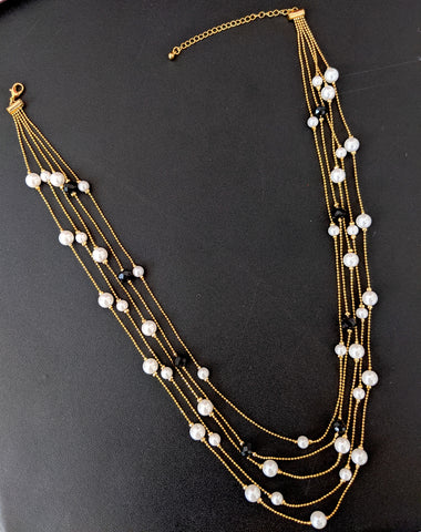 Multi stranded faux pearl and black bead chain necklace for western wear
