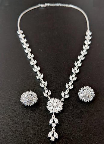Platinum finish white Swarovski like stone embedded party wear necklace and stud earring set