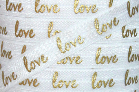 "White/Gold Metallic ""love"" Print 5/8"" Fold Over Elastic"