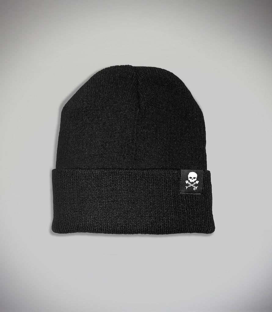 Outcast Black Slouch Beanie Flat Lay Cuff up with black embroidered skull icon tag