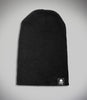 Outcast Black Slouch Beanie Flat Lay Cuff down with black embroidered skull icon tag