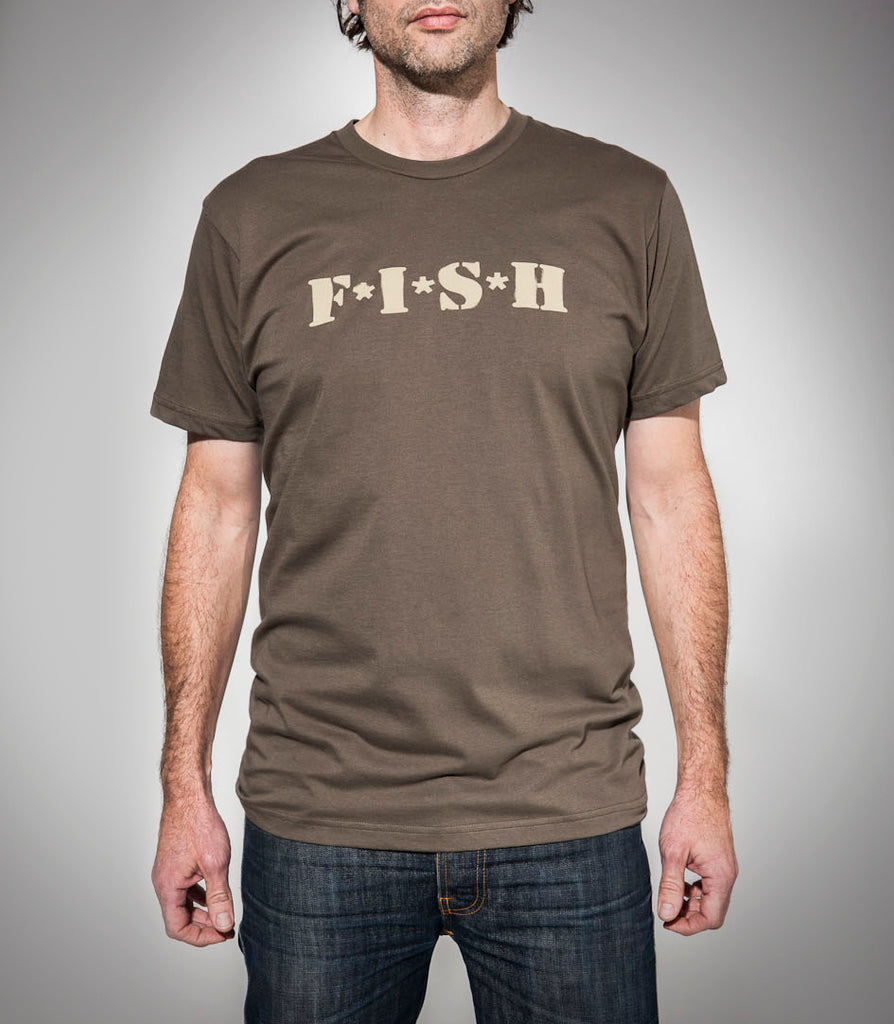outcast FISH logo khaki t-shirt on talent full length front view