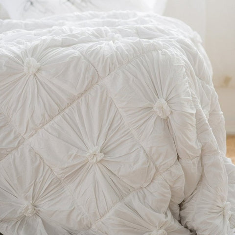 QUILT | white rosette design in organic cotton by lazybones