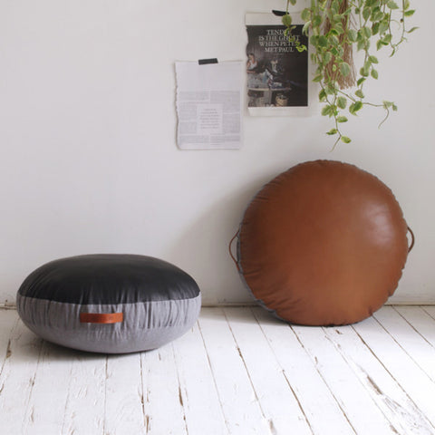 FLOOR CUSHION  | leather circular in black by amigos de hoy