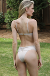 nude ruched Brazilian bikini bottoms. high cut