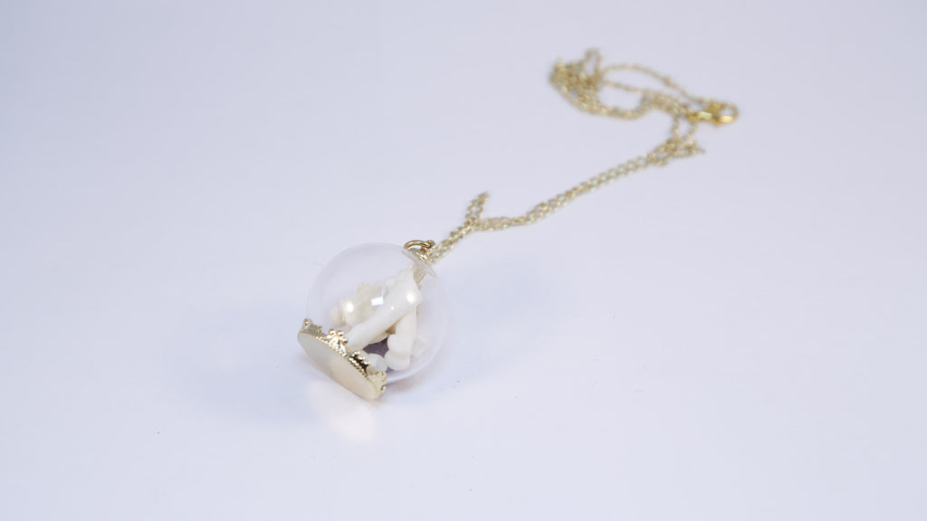 We're All Animals Glass Globe Necklace-Raw Ruby