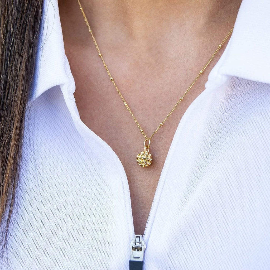 Golf Goddess gold golf ball necklace by Chelsea Charles