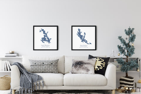 Framed lake map prints on a living room wall