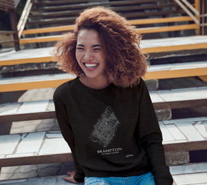 white streets of Brampton, Ontario, on black crewneck sweatshirt with female model