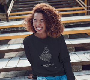 white streets of Mississauga, Ontario, on navy crewneck sweatshirt with female model