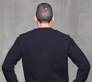 back of navy blue crewneck sweatshirt on male model