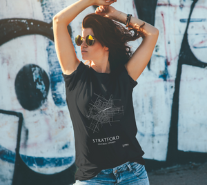white streets of Stratford, Ontario, on black classic unisex tshirt with female model