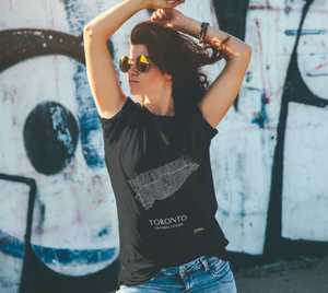 white streets of Toronto, Ontario, on black classic unisex tshirt with female model