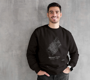 white streets of Brampton, Ontario, on black crewneck sweatshirt with male model
