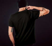 Load image into Gallery viewer, back of black classic unisex tshirt with male model