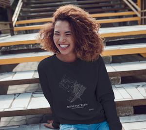 white streets of Burlington, Ontario, on navy blue crewneck sweatshirt with female model
