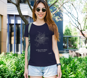 white streets of Stratford, Ontario, on navy fitted tshirt with female model