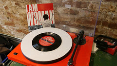 """I Am Woman"" 7"" vinyl single, with ""Exodus"" b-side."