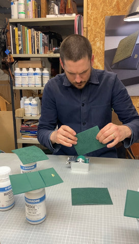 Daniel Ankarstrand painting the edges of the card holder