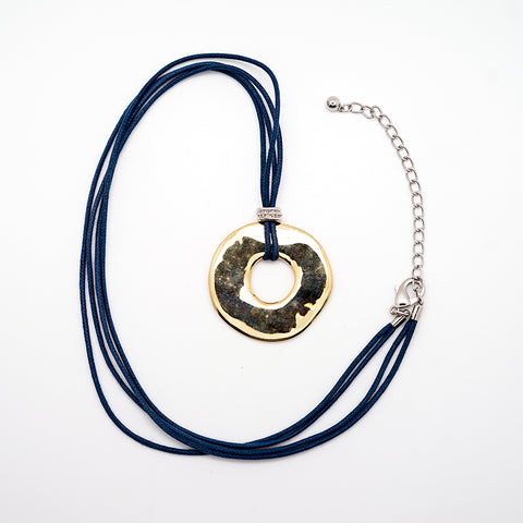 Gold Circle Pendant on Blue Leather Cord - 24 Inches