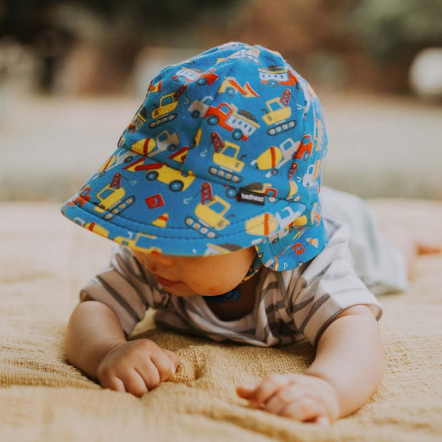 Bedhead Hats Construction Legionnaire baby boy hat on crawling baby