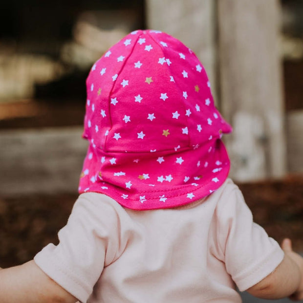 Back view of Bedhead Hats Nova print on baby girl