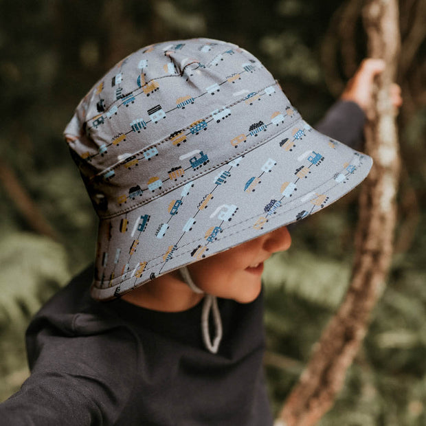 Side view of Bedhead Hats toddler bucket hat with trains print