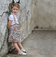 Toddler girl wearing Bibi white sandals