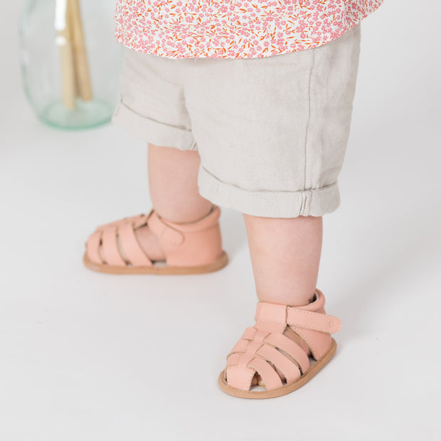 Pretty Brave Rio pink baby sandals on child
