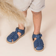 Toddler boy wearing Pretty Brave Rocco denim sandals