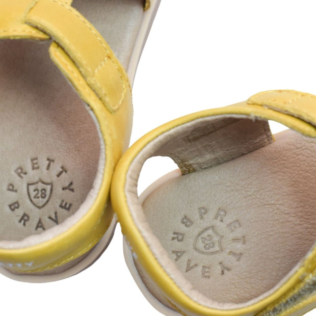 Close up of Pretty Brave logo on sandals