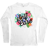 White long sleeve shirt with flowers and the words self care on it
