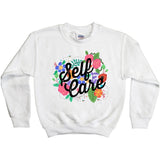 White sweatshirt with illustration of flowers and the words self care
