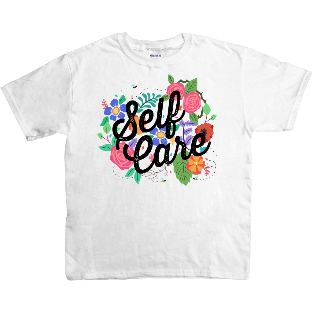 White t-shirt with illustration of flowers and the words Self Care