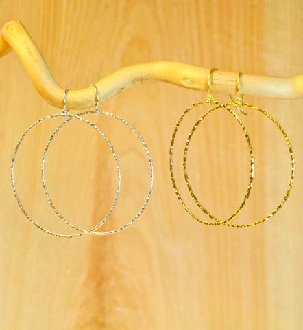 LARGE CIRCLE LIGHT EARRINGS