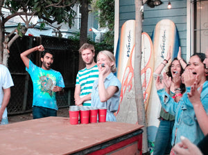 happy friends, beer pong, game day, football, surf boards, sustainability, party cups